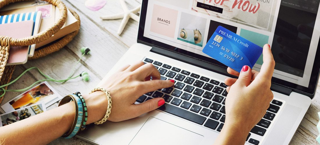 woman shopping online and using credit card to pay